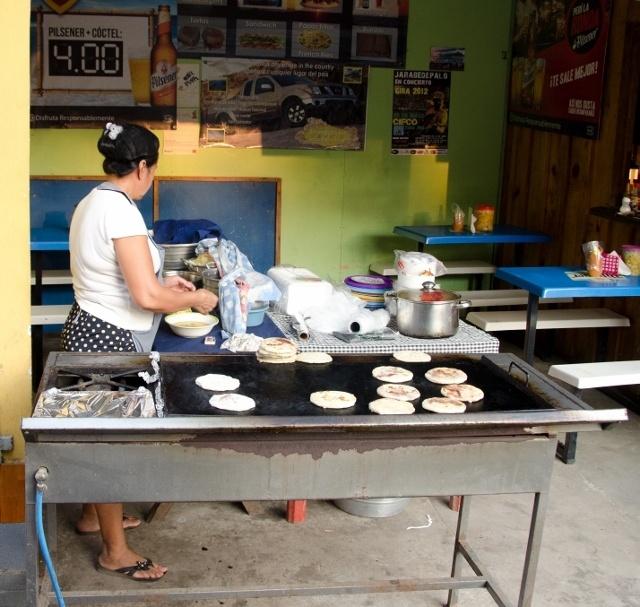 Read more about the article Grown-up Travel Guide Daily Photo: Pupusa vendor, La Libertad, El Salvador
